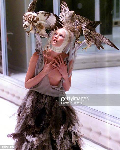 A model presents a creation by Alexander Mcqueen for the Spring/Summer collection at London fashion week in London 26 September 2000