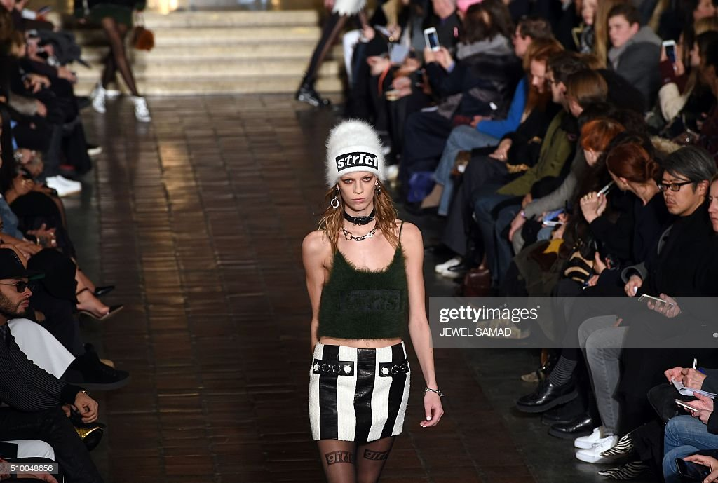 A model presents a creation by Alexander Wang, during the Fall 2016 New York Fashion Week at the Saint Bartholomew's Chrurch in New York on February 13, 2016. / AFP / Jewel Samad