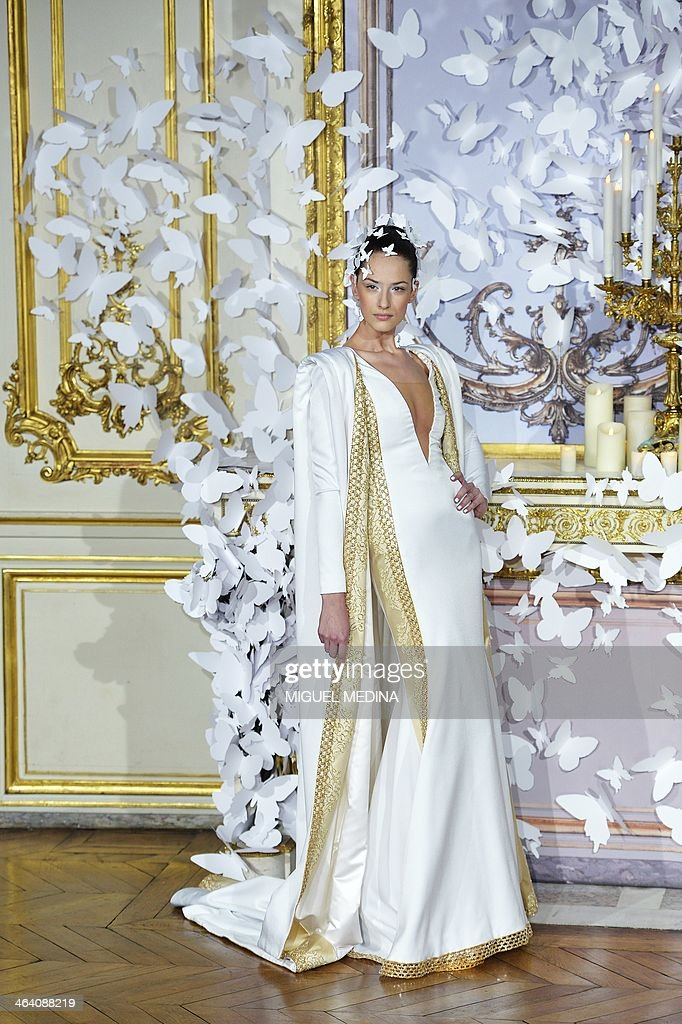 A model presents a creation by Alexis Mabille during the Haute Couture SpringSummer 2014 collection show on January 20 2014 in Paris AFP PHOTO /...