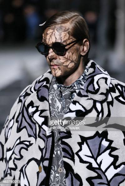 A model presents a creation by American designer Thom Browne during the Fall/Winter 2014/2015 men's fashion show in Paris on January 19 2014 AFP...