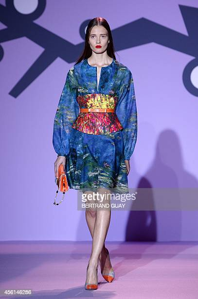 A model presents a creation by Andrew GN during the 2015 Spring/Summer readytowear collection fashion show on September 26 2014 in Paris AFP PHOTO /...