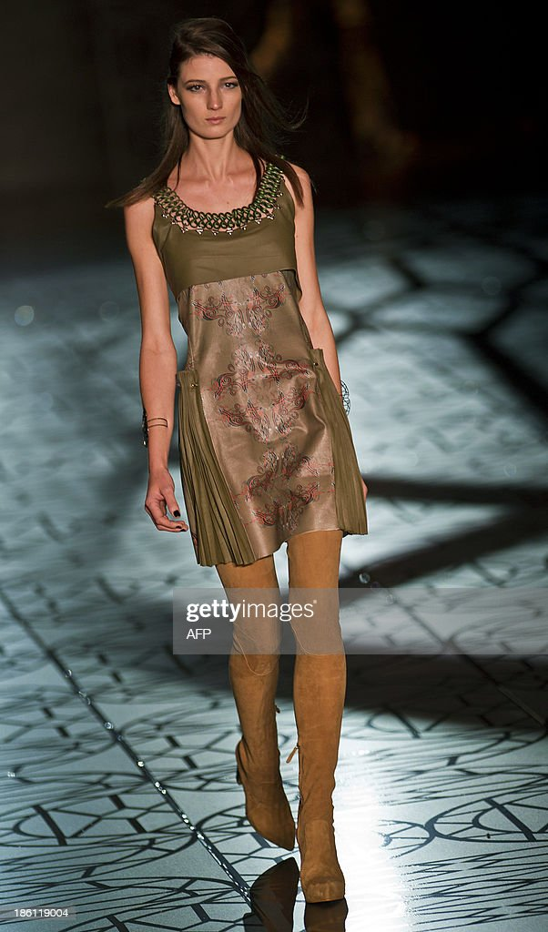 A model presents a creation by Animale during the 2013 Winter collections of the Sao Paulo Fashion Week in Sao Paulo, Brazil, on October 28, 2013. AFP PHOTO / Nelson ALMEIDA