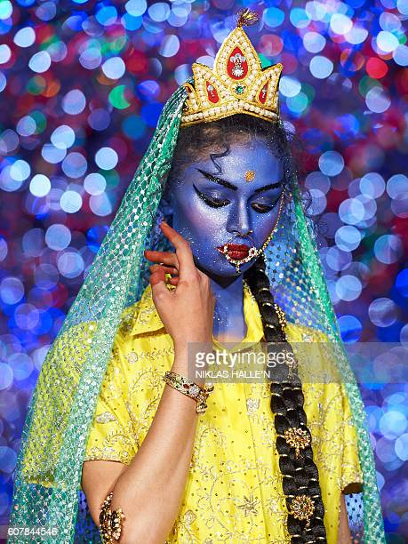 TOPSHOT A model presents a creation by Ashish during the 2017 Spring / Summer catwalk show at London Fashion Week in London on September 19 2016 /...