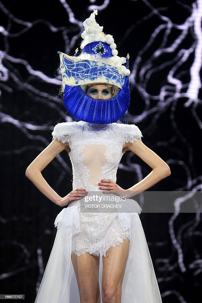 A model presents a creation by Belarus' designer Aleksei Kirilyuk during the annual international festival Mill of Fashion in Minsk on May 4, 2013.