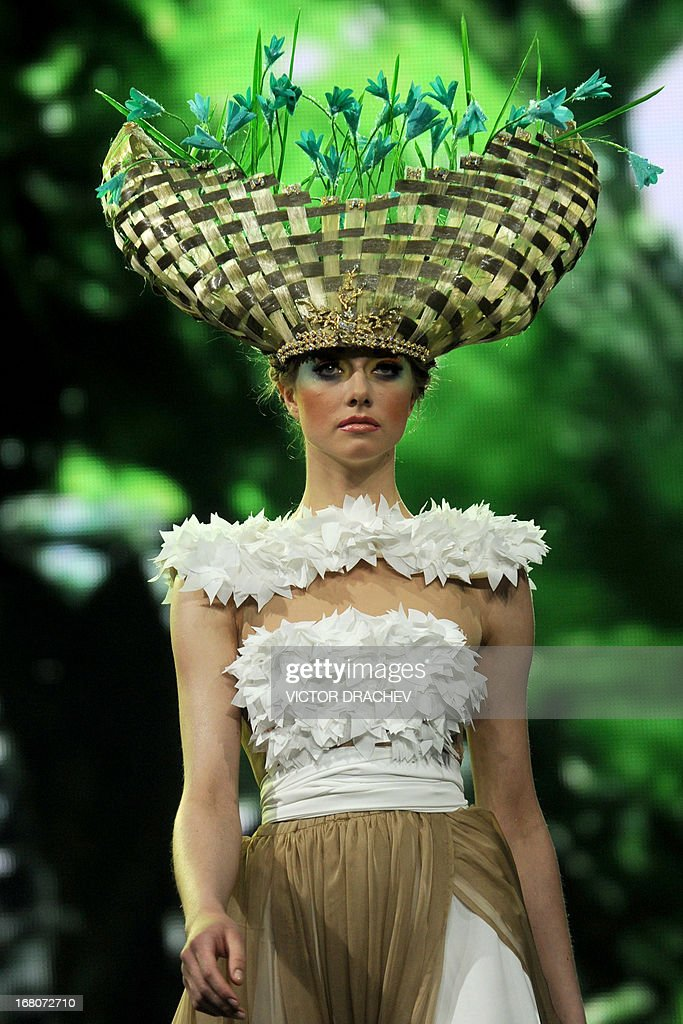 A model presents a creation by Belarus' designer Aleksei Kirilyuk during the annual international festival Mill of Fashion in Minsk on May 4, 2013. AFP PHOTO/VIKTOR DRACHEV
