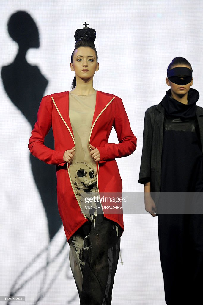 A model presents a creation by Belarus' designer Natalia Kostsova on the annual international festival Mill of Fashion in Minsk late on May 4, 2013.