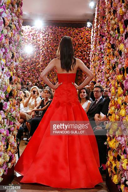 A model presents a creation by Belgian designer Raf Simons for Christian Dior during the Haute Couture FallWinter 20122013 on July 2 2012 in Paris...