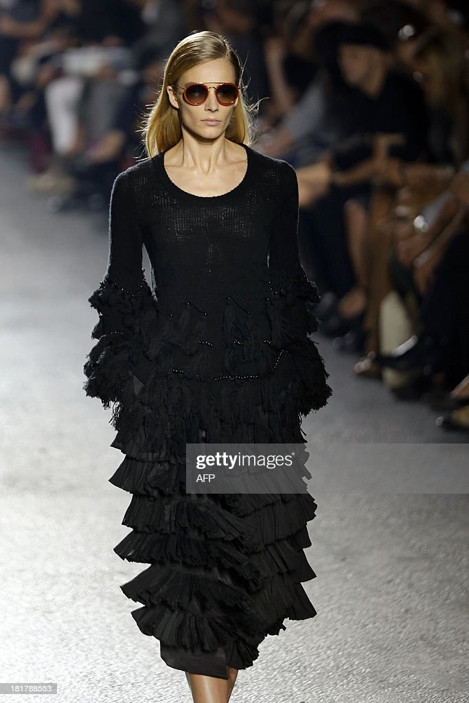 A model presents a creation by Belgian fashion designer Dries Van Noten during the 2014 Spring/Summer ready-to-wear collection fashion show, on September 25, 2013 in Paris.