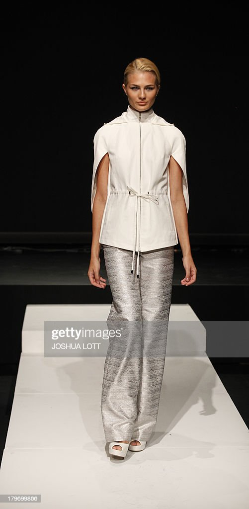 A model presents a creation by Blaise Kavanagh during the Fashion Law Institute fashion show at the Mercedes-Benz Fashion Week Spring 2014 collections on September 6, 2013 in New York. AFP PHOTO/Joshua Lott