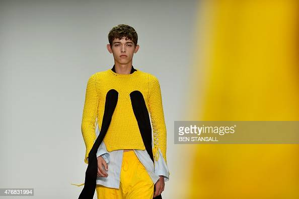 A model presents a creation by British designer Craig Green on the opening day of the Spring/Summer 2016 London Collections Men fashion event in...