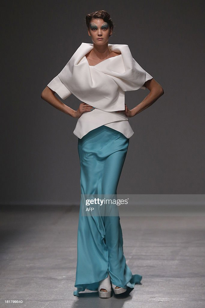 A model presents a creation by British fashion designer Gareth Pugh during the 2014 Spring/Summer ready-to-wear collection fashion show, on September 25, 2013 in Paris.