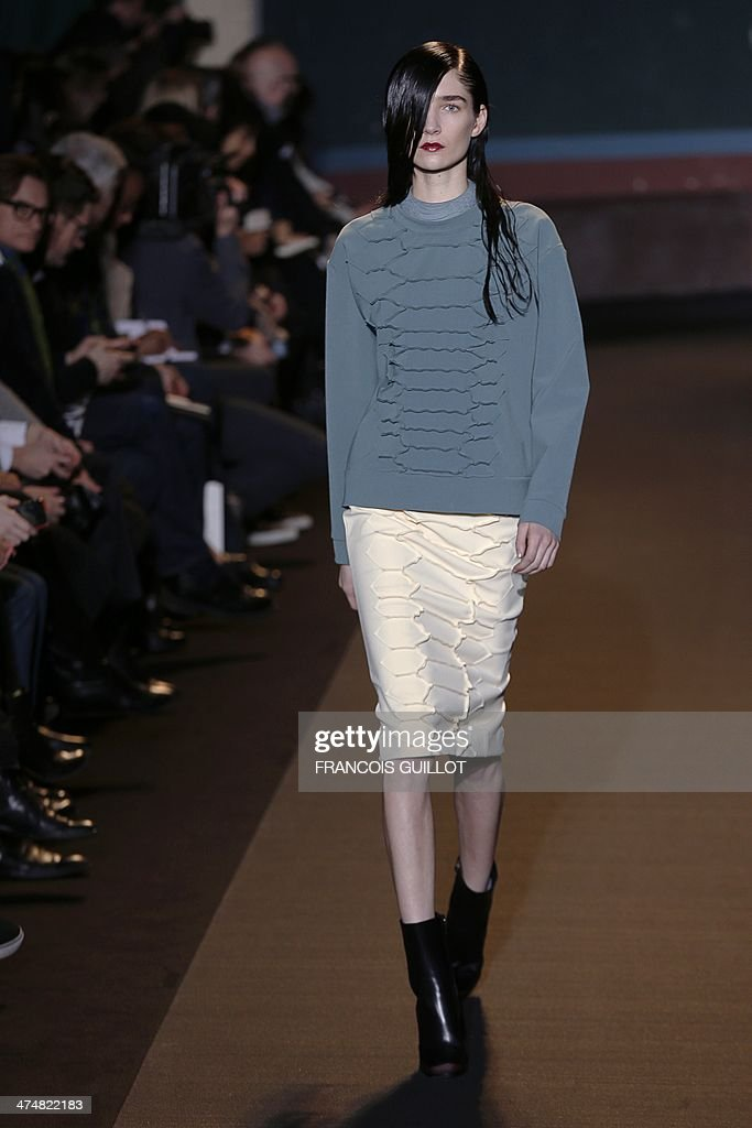 A model presents a creation by Cedric Charlier during the 2014 Autumn/Winter ready-to-wear collection fashion show, on February 25, 2014 in Paris.