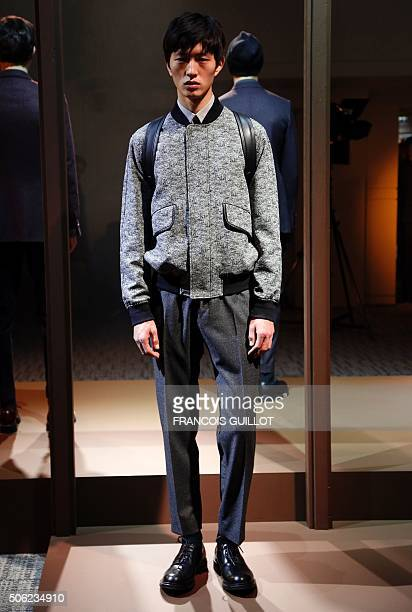 A model presents a creation by Cerruti during the men's Fashion Week for the 20162017 Fall/Winter collection on January 22 2016 in Paris / AFP /...