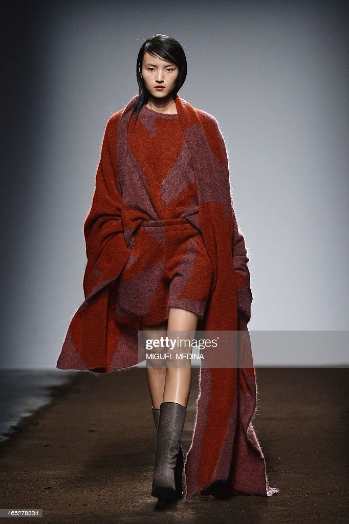 A model presents a creation by Christian Wijnants during the 20152016 fall/winter readytowear collection fashion show on March 5 2015 in Paris AFP...