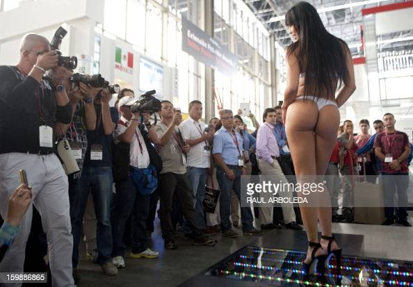 A model presents a creation by Colombian brand St Even during the Colombiatex fashion show on January 22 2013 in Medellin Antioquia department...
