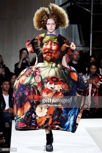 TOPSHOT A model presents a creation by Comme des garcons during the women's 2018 Spring/Summer readytowear collection fashion show in Paris on...