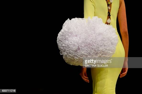 A model presents a creation by Cristina Garcia during the SIMOF 2017 in Sevilla on February 3 2017 / AFP / CRISTINA QUICLER