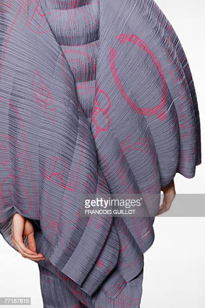 A model presents a creation by Dai Fujiwara for Issey Miyake during the Spring/Summer 2008 readytowear collection show in Paris 02 October 2007 AFP...