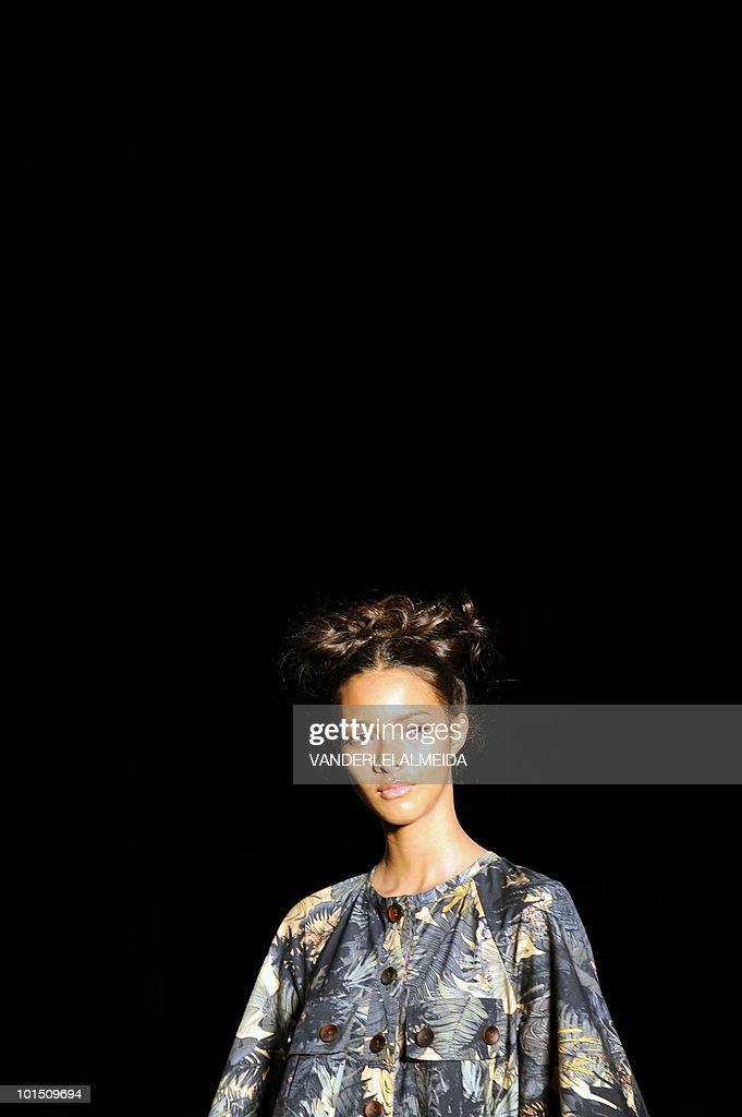 A model presents a creation by designer Andrea Nascimento during the Rio Fashion Week, Summer 2010/2011 collection, at the Pier Maua, in Rio de Janeiro, Brazil on June 1 2010.