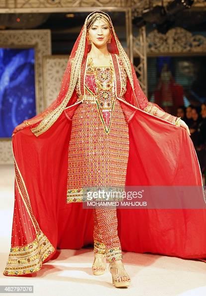 A Model Presents A Creation By Designer Faiza Al Balushi During A Fashion Show Organised As Part