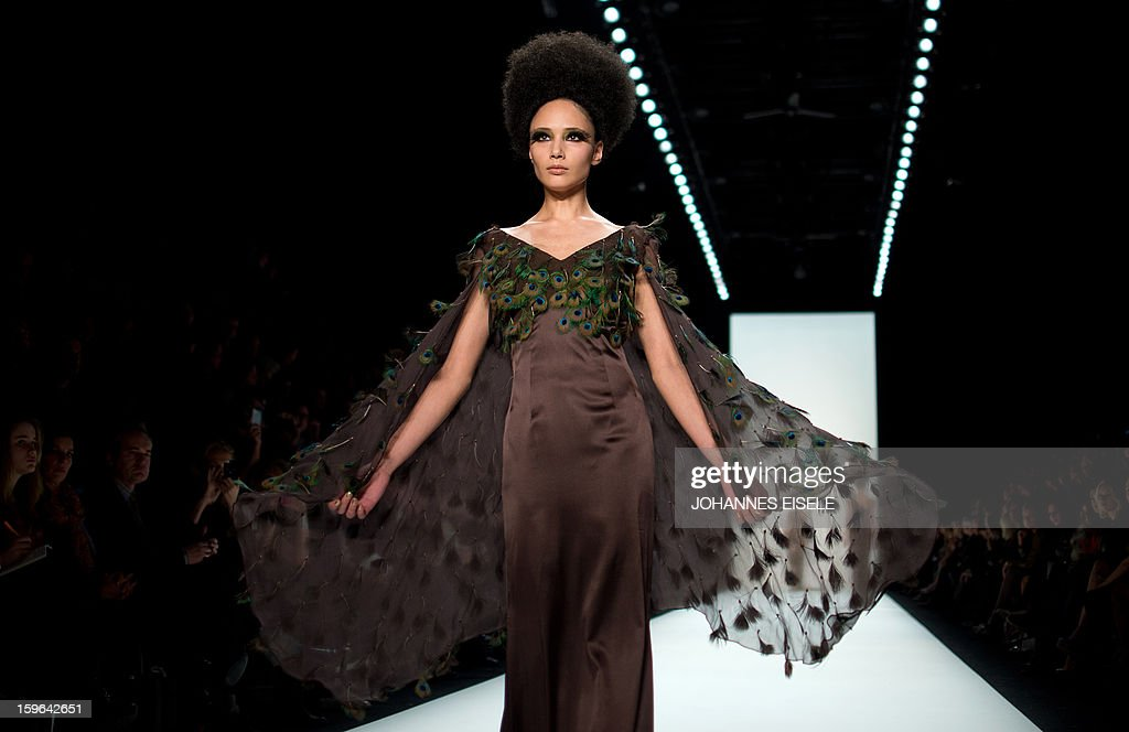 A model presents a creation by designer 'Guido Maria Kretschmer' during the Autumn/Winter 2013 shows of the Mercedes-Benz Fashion Week on January 17, 2013 in Berlin. The Berlin Fashion Week takes place from January 15 to 20, 2013.