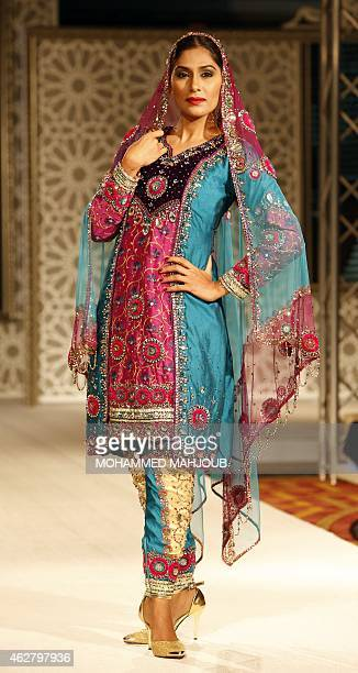 A model presents a creation by designer Hana alOheibeh during a fashion show organised as part ot the Muscat Festival on February 5 2015 in the Omani...