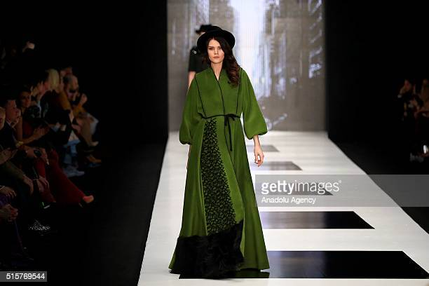 A model presents a creation by designer Igor Gulyaev during the 2016/2017 Fall/Winter MercedesBenz Fashion Week Russia in Moscow on March 15 2016