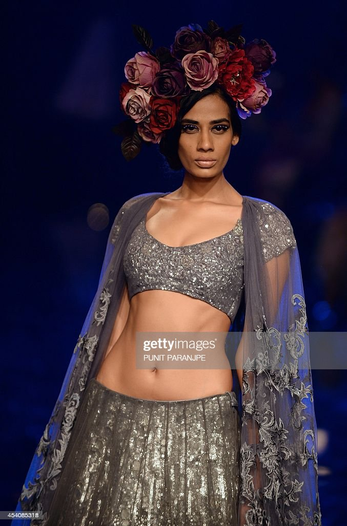 A model presents a creation by designer Manish Malhotra during the grand finale of Lakme Fashion Week (LFW) Winter/Festival 2014 in Mumbai on August 24, 2014.