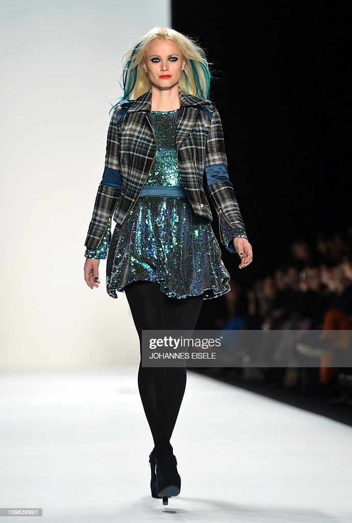 A model presents a creation by designer Marcel Ostertag during the Autumn/Winter 2013 shows of the Mercedes-Benz Fashion Week on January 17, 2013 in Berlin. The Berlin Fashion Week takes place from January 15 to 20, 2012.