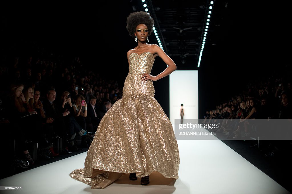 A model presents a creation by designer 'Marcel Ostertag' during the Autumn/Winter 2013 shows of the Mercedes-Benz Fashion Week on January 17, 2013 in Berlin. The Berlin Fashion Week takes place from January 15 to 20, 2013.