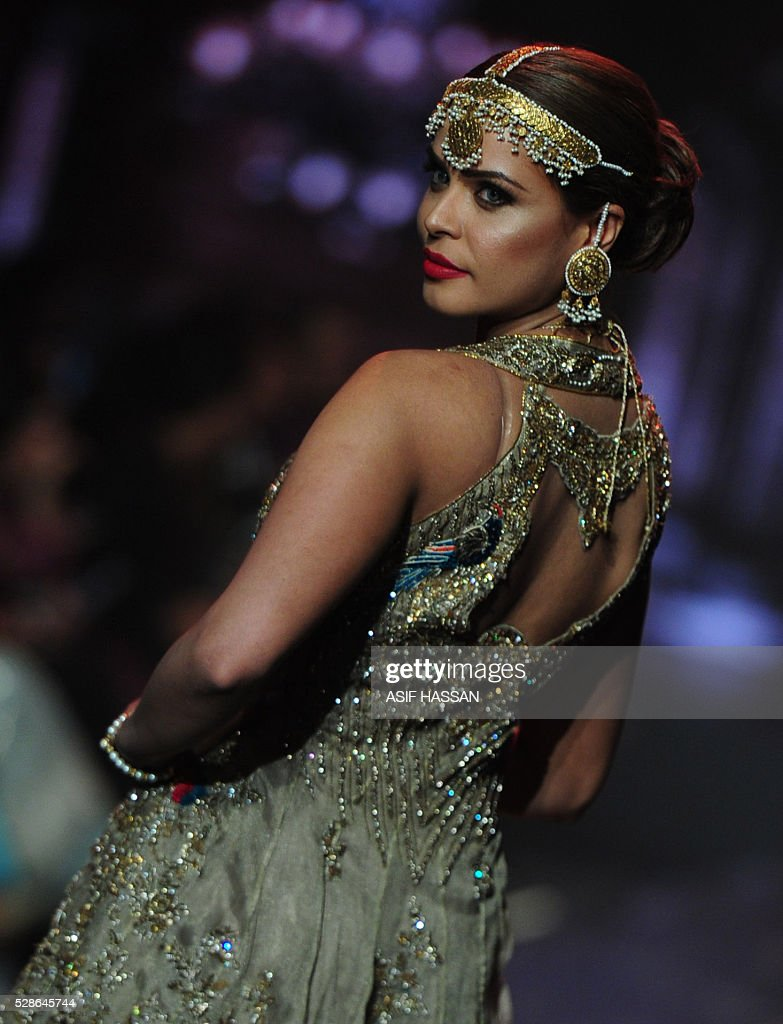 A model presents a creation by designer Mohsin Naveed Ranjha on the first day of Bridal Couture Week-Gold Edition in Karachi on May 6, 2016. / AFP / ASIF