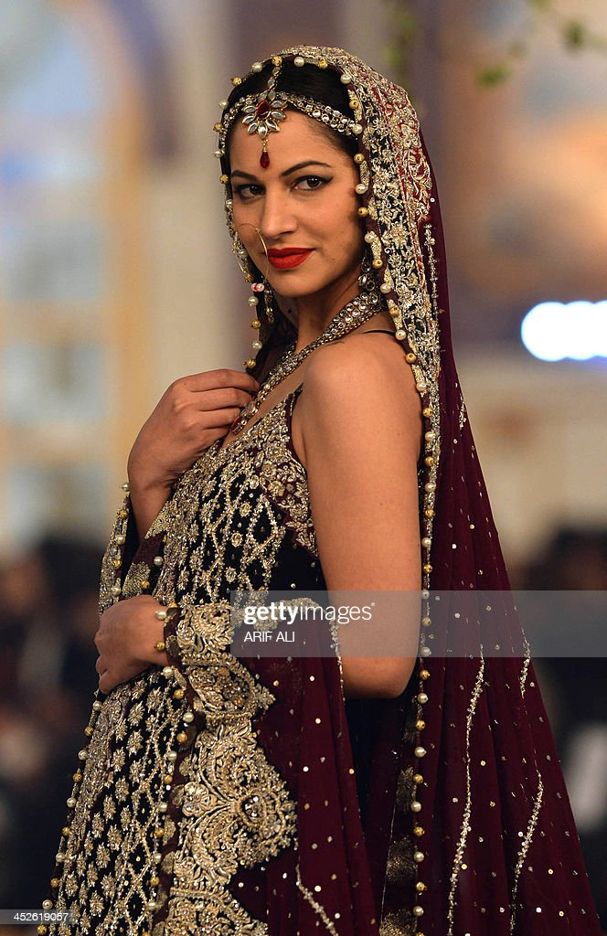 A model presents a creation by designer Zainab Chottani at the Pantene Bridal Couture Week 2013 in Lahore on late November 30, 2013. AFP PHOTO/Arif ALI