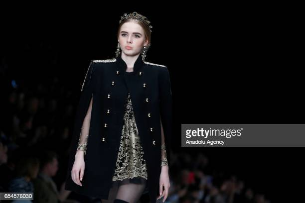 A model presents a creation by designers of Slava Zaitsev presents Fashion Laboratory during the 2017/2018 Fall/Winter MercedesBenz Fashion Week...
