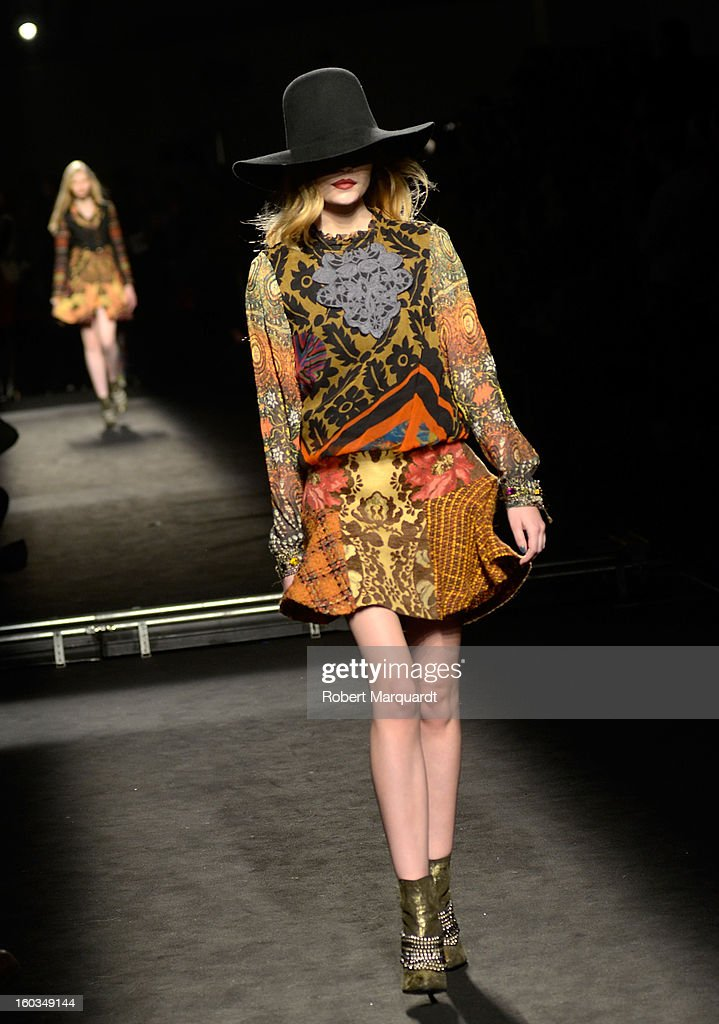 A model presents a creation by Desigual during the 080 Barcelona 'Autumn-Winter 2013-2014' fashion week in Barcelona on January 29, 2013 in Barcelona, Spain.