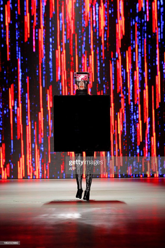 A model presents a creation by Dutch fashion designer Marga Weimans during the 18th edition of the Amsterdam Fashion Week in Amsterdam, on January 27, 2013. The Fashion Week runs from 18 to 27 January.