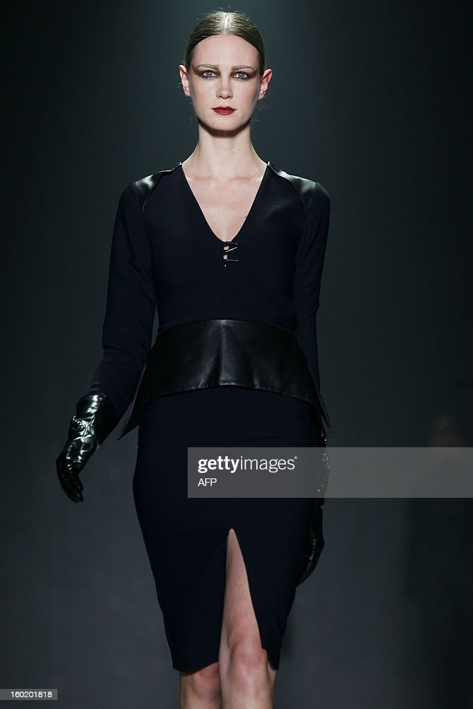 A model presents a creation by Dutch fashion designer Tony Cohen during the 18th edition of the Amsterdam Fashion Week in Amsterdam, on January 27, 2013. The Fashion Week runs from 18 to 27 January.