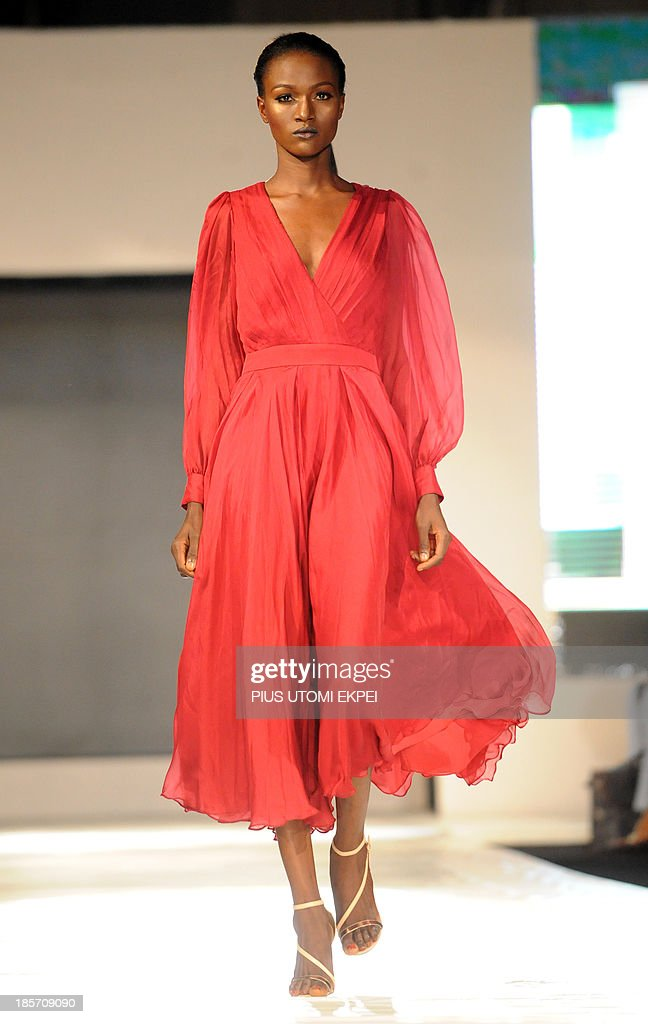A model presents a creation by Ella and Gabby during the Lagos Fashion and Design Week on October 23, 2013. The four-day Lagos Fashion and Design Week features 37 both local and international designers with their innovative and eclectic designs. This year's edition tagged 'building from within' aims to drive the Nigerian fashion industry and lift its profile by bringing together buyers, consumers and the media to view the current collections of designers toward positioning the platform as the hub for commerce and creativity on the continent.