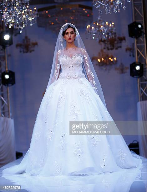 A model presents a creation by Emirati fashion designer Mona alMansouri during the Gulf's Forum of Elegance event on December 21 2014 in the Omani...