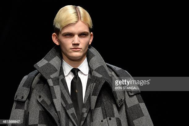 A model presents a creation by ETautz during the Autumn/Winter 2014 London Collections Mens fashion event in London on January 8 2014 AFP PHOTO/BEN...