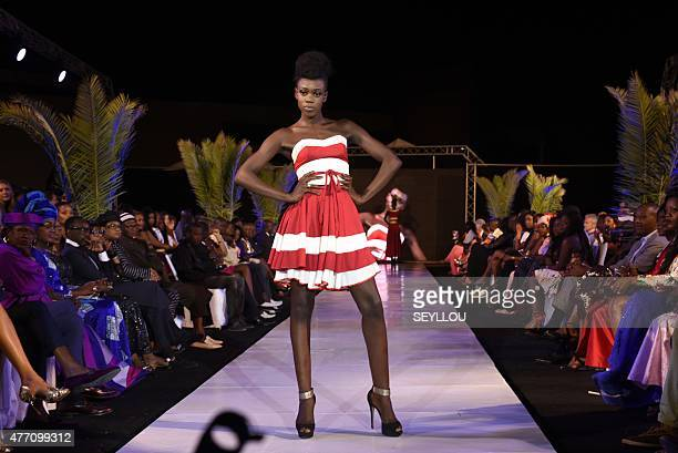 A model presents a creation by fashion designer Angelique Diedhiou during the 15th edition of Dakar Fashion Week on the Place de l'Obelisque in Dakar...