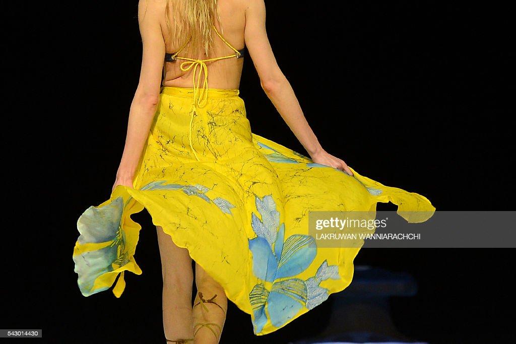 A model presents a creation by fashion designer Darshi Keerthisena at the Swim Week Colombo fashion show at the Port of Colombo on June 25, 2016. Swim week Colombo fashion show includes designers from Sri Lanka, Australia, India, Britain and the United States. / AFP / LAKRUWAN