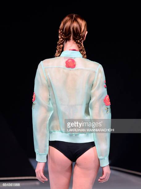 A model presents a creation by fashion designer Rimzim Dadu at the Colombo fashion week in Colombo on March 17 2017 / AFP PHOTO / LAKRUWAN...