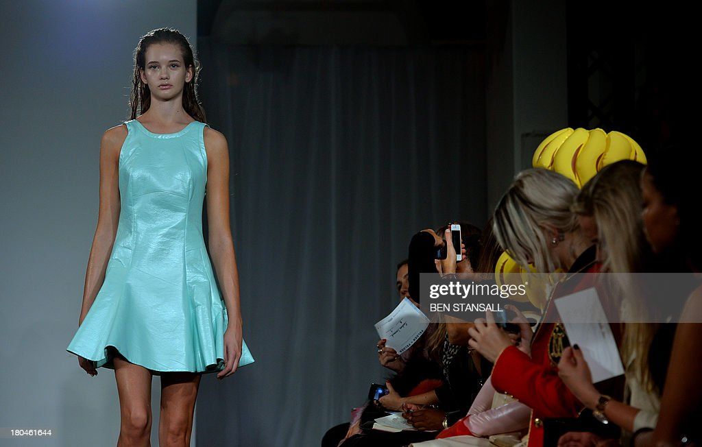 A model presents a creation by Felder Felder during the 2014 Spring/Summer London Fashion Week in London on September 13, 2013.