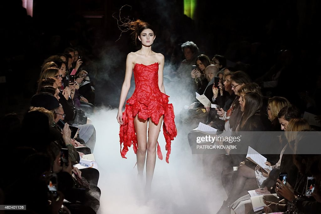 A model presents a creation by Frank Sorbier during the 2015 Haute Couture SpringSummer collection fashion show on January 28 2015 in Paris AFP PHOTO...