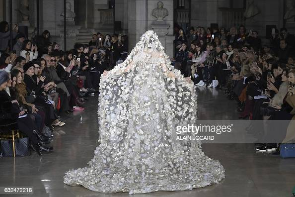 TOPSHOT A model presents a creation by Georges Hobeika during the 2017 spring/summer Haute Couture collection on January 23 2017 in Paris / AFP /...