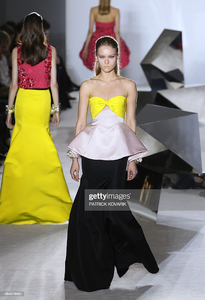 A model presents a creation by Giambattista Valli during the Haute Couture Spring-Summer 2014 collection show, on January 20, 2014 in Paris.