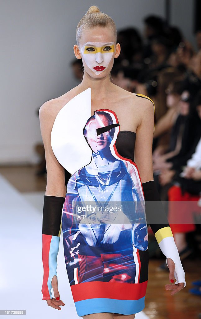 A model presents a creation by Ground Zero during the 2014 Spring/Summer ready-to-wear collection fashion show, on September 24, 2013 in Paris.