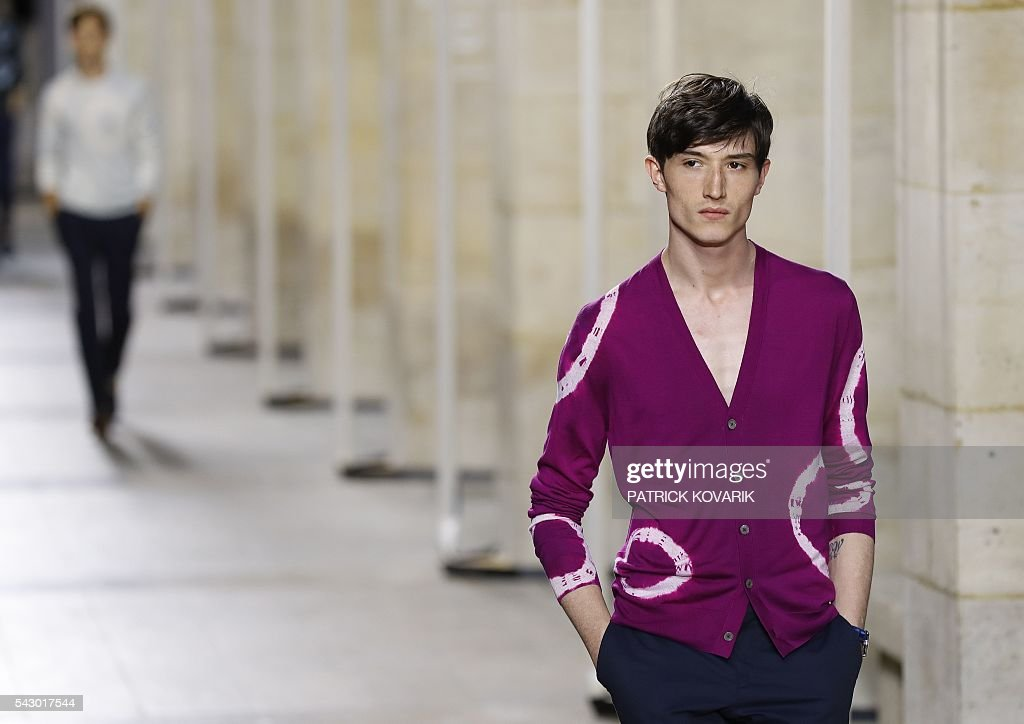 A model presents a creation by Hermes during the men's Spring/Summer 2017 collection fashion show on June 25, 2016 in Paris. / AFP / PATRICK