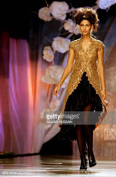 A model presents a creation by Indian designer Anamika Khanna on the fourth day of the HDIL India Couture Week in Mumbai on September 19 2008 India...