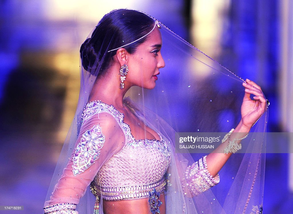 A model presents a creation by Indian designer Tarun Tahiliani during the Grand Finale of Indian Bridal Fashion Week in New Delhi on July 28, 2013.